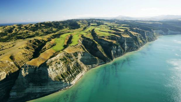 An aerial view of the entire golf course perched on the cliffs.