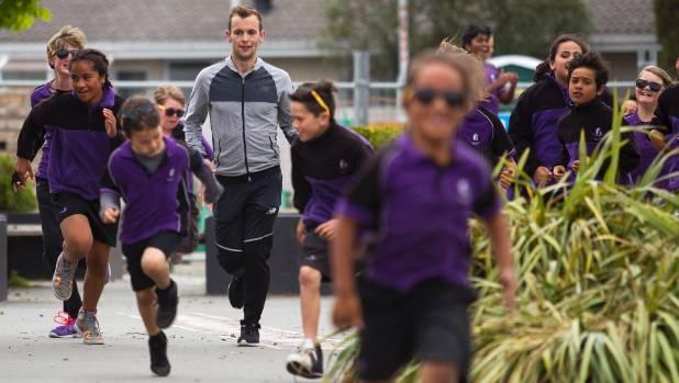 New Zealand half-marathon champ Oska Inkster-Baynes took a group of students from Te Waka Unua School through a training ...