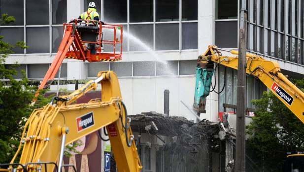 A demolition crew works at demolishing a building on Molesworth St damaged after the earthquake.
