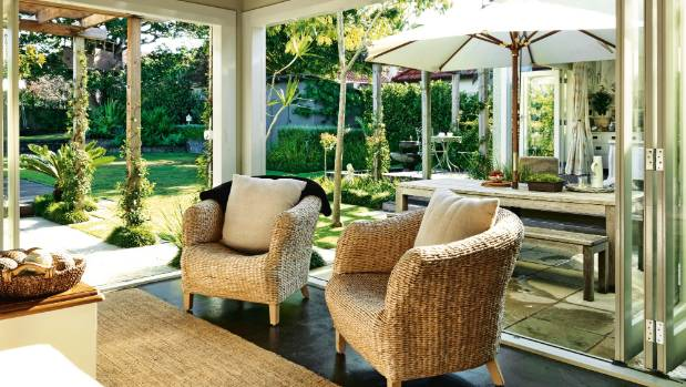 This living room opens up to the lawn and outdoor dining area.