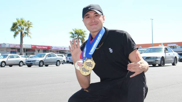 Carlos Skipper with his medals from several international dance competitions.