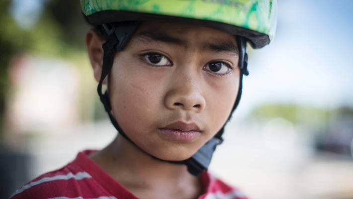 """Suwat Piper, 9, says: """"My uncle is the best skateboarder, he taught me to skate about three years ago, now I stake to school every day."""""""