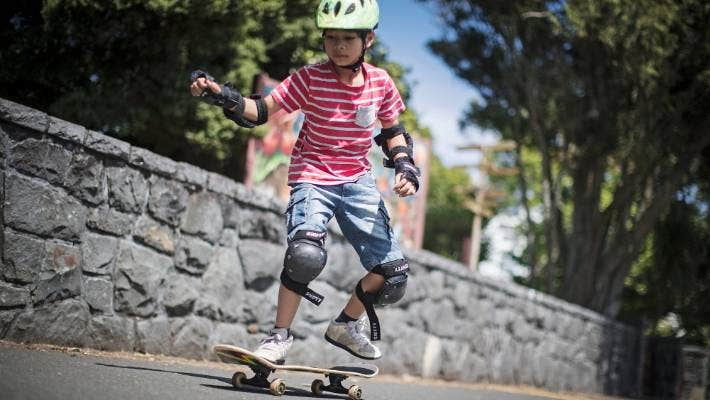 """Suwat Piper says: """"I live just down the road so it's not too far away, but I always wear my helmet and walk my skateboard across roads to be safe."""""""