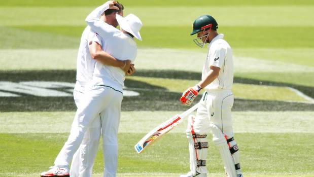 Australian David Warner of Australia walks off after getting out to South Africa pace bowler Kyle Abbott.