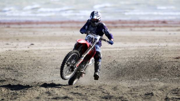 Randell Scott takes part in the New Zealand Beach Race Championships as part of the Burt Munro Challenge at ...