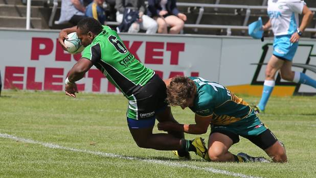 Vatili Tora scores for South Canterbury at the Southern Regional Sevens depite Mid Canterbury's Oliver Sapsford's ...
