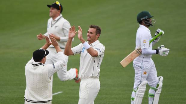 Tim Southee and his New Zealand team-mates celebrate the dismissal of Pakistan's Azhar Ali in the second test in Hamilton.