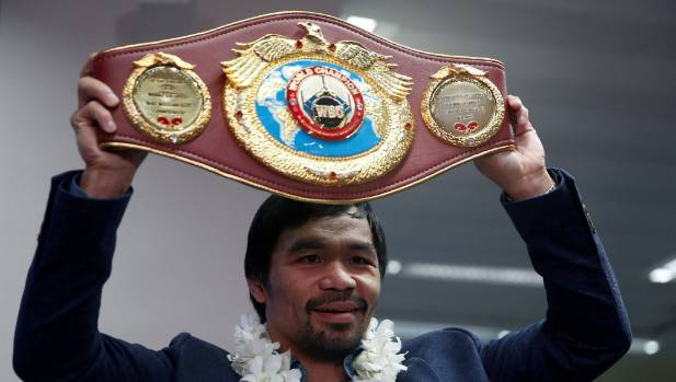 Manny Pacquiao holds the WBO welterweight belt aloft after his victory over Jessie Vargas.
