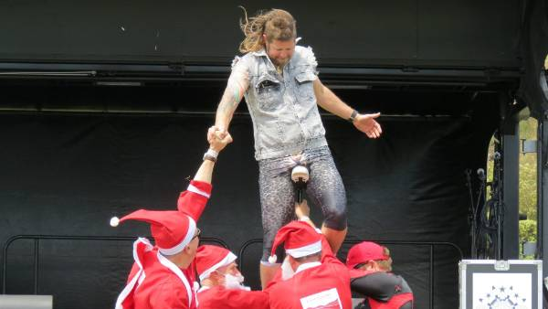 Busker Mullet Man is supported by the Santa runners from Eliot Sinclair in his last trick.