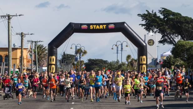 Runners leaving the start line in New Brighton for the 10km race.
