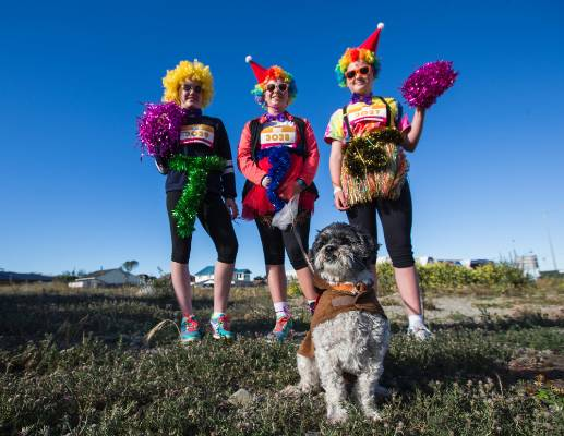 Sarah Marshall, 12 years old, from the left, Marnie Hall, 13 years old and Ava Davidson, 12 years old with dog, Ziggy in ...