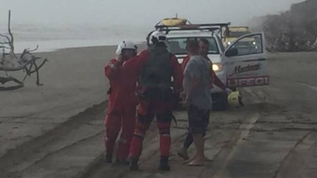 The Auckland Westpac Rescue Helicopter crew attends after the Francie capsized in the Kaipara Harbour on November 26.