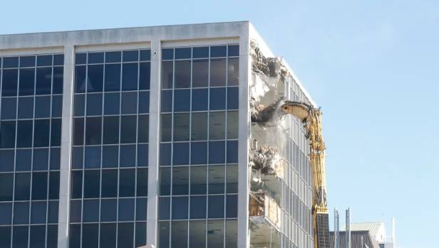 Demolition began on Monday morning on 61 Molesworth St, a condemned office building that was damaged in the November 14 ...