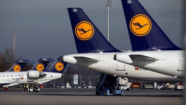 Planes stand on the tarmac during a pilots strike of German airline Lufthansa at Munich airport, Germany.
