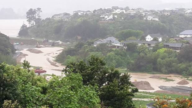 Duck Creek in Porirua in full flood on November 15. The earthmovers for Brookside can be seen on the left.