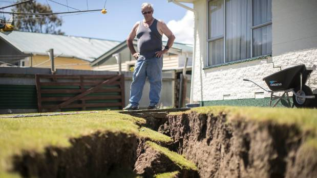 "Paul Guthrie at his badly damaged home in Kaikoura. He reckons it is a ""write off""."