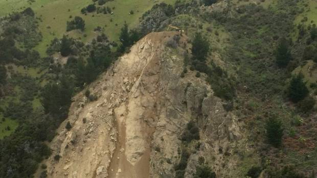 Paul O'Sullivan has the unenviable job of moving debris from the top of this slip in Marlborough.
