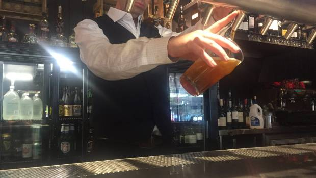 Bar manager Gordon Douglas pours a pint for a customer during the lunch rush: but is the trend on the wane?