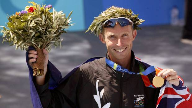 Hamish Carter celebrates winning Olympic triathlon gold in Athens in 2004.