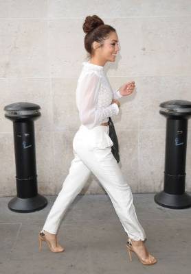 Vanessa Hudgens dressed smart casual - a look that could work at a Christmas party, according to Jackie O'Fee.