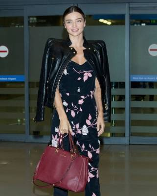 "Miranda Kerr, dressed ""smart casual'', although Jackie O'Fee says she needs a smaller bag."