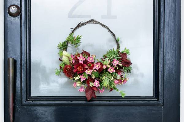 Choose to go a bit out of the ordinary this Christmas; instead of creating a full circle wreath, simply arrange your ...