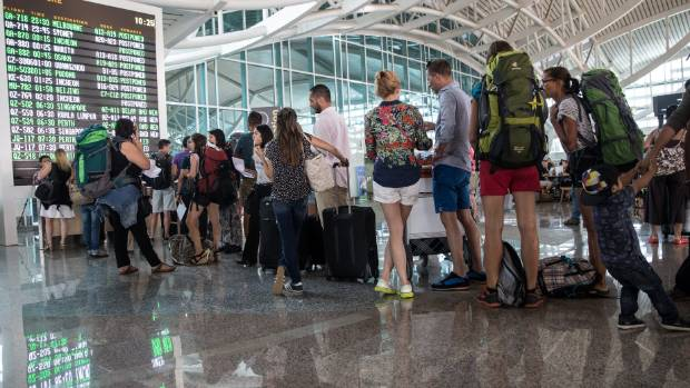 A behaviour expert says passengers start forming lines to board a plane before the gate has opened.