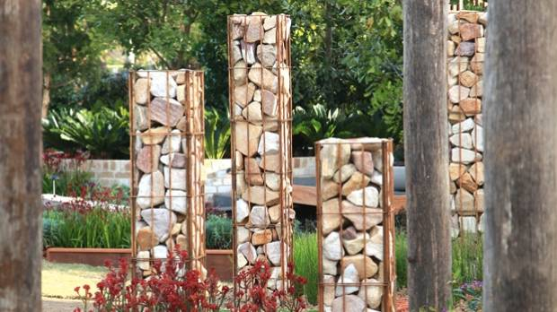 Rock gabions from an outer wall are repeated in these clever columns.