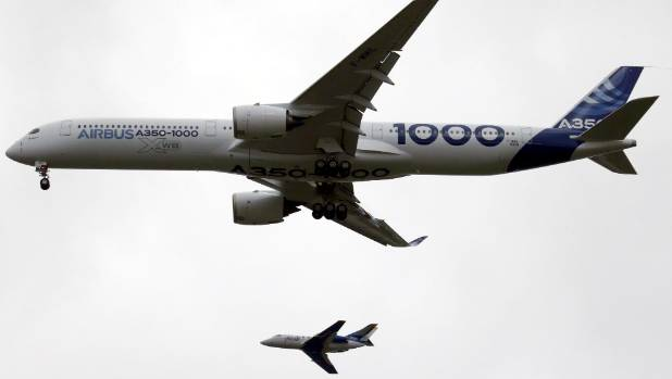 The Airbus A350-1000 lands during its maiden flight event in Colomiers near Toulouse, Southwestern France.