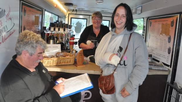 Anna Sutherland receives a coffee from Bean Brewed 4 You owner Jan Webling, while fellow owner Keith Webling adds ...