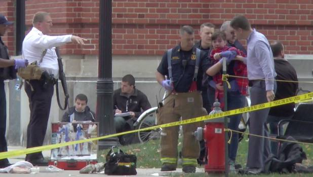 A girl is led to an ambulance by emergency personnel following an attack at Ohio State University's campus in Columbus, ...