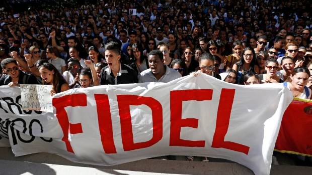 Students of Havana University pay tribute to Cuba's late president Fidel Castro as they march to Revolution Square in ...