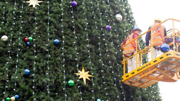 Workers are setting up the 27-metre-high Christmas Tree at Garden Place, with a brand new set of Christmas lights.