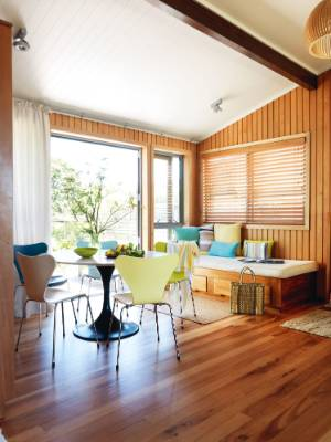 The original timber-lined walls and polished floorboards were retained but the ceiling was painted white; for privacy, ...