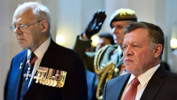 King Abdullah of Jordan, right, pays his respects with Rear Admiral David Ledson during a wreath-laying ceremony at the ...