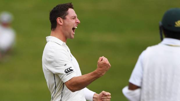 Bowler Matt Henry celebrates the wicket of Asad Shafiq.