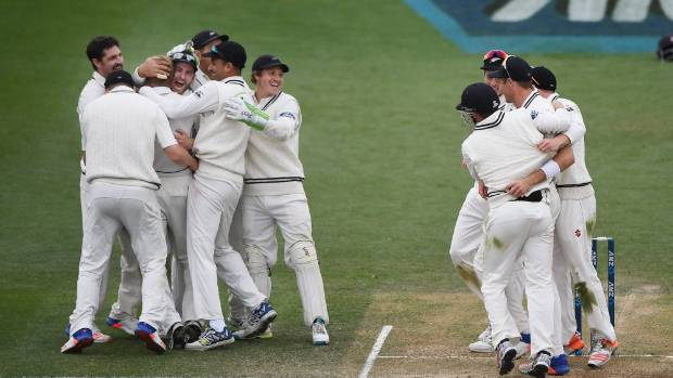New Zealand players celebrate winning the match and the series 2-0 against Pakistan in Hamilton.