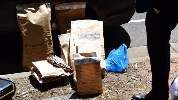 Bags of evidence seized during the raids in Sydney Olympic Park on Tuesday.