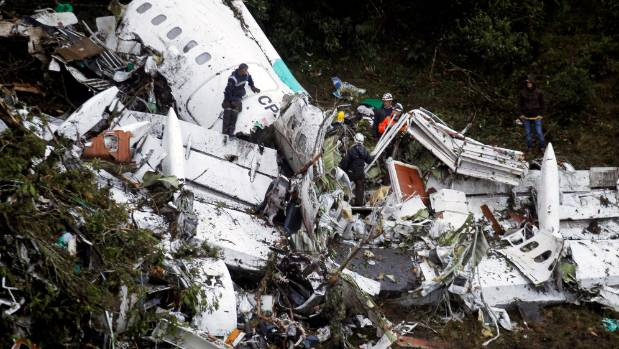 Rescue crew work in the wreckage from a plane that crashed into Colombian jungle.