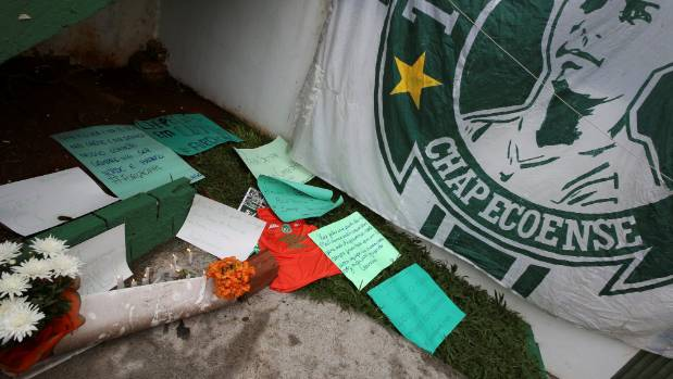 Flowers and messages are seen next to a Chapecoense team flag in tribute to their players in front of the Arena Conda ...