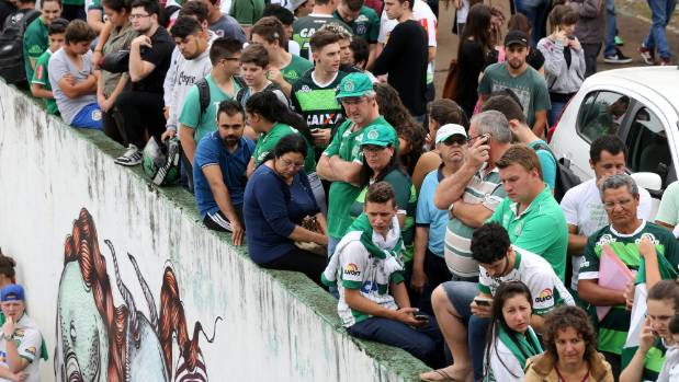 Mourning fans of Chapecoense gather outside Arena Conda stadium in Chapeco, Brazil, following the fatal plane crash ...
