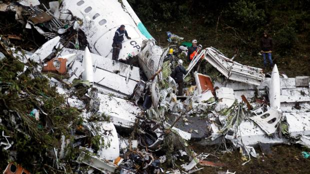 Rescue crew work in the wreckage of a plane that crashed into Colombian jungle to recover bodies near Medellin, Colombia.