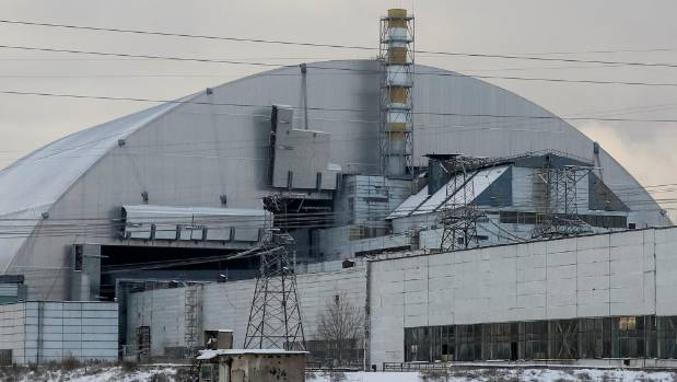 The New Safe Confinement (NSC) structure over the old sarcophagus covering the damaged fourth reactor at the Chernobyl ...