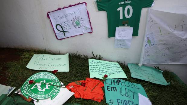 Flowers and messages for the players have been left in front of the Arena Conda stadium in Chapeco, Brazil.