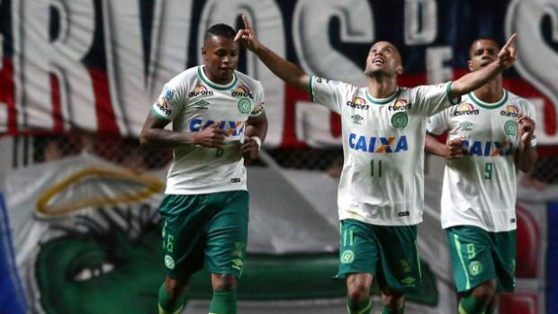 Players Dener, Ananias and Bruno Rangel, celebrate a goal against San Lorenzo in Buenos Aires, Argentina, on November 2.