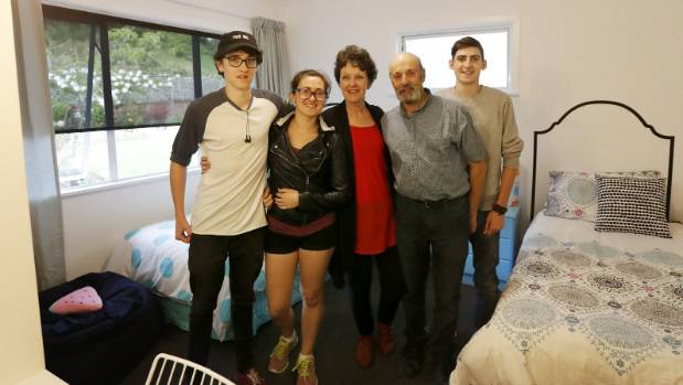 The Perrone family in one of their home's newly-renovated bedrooms.