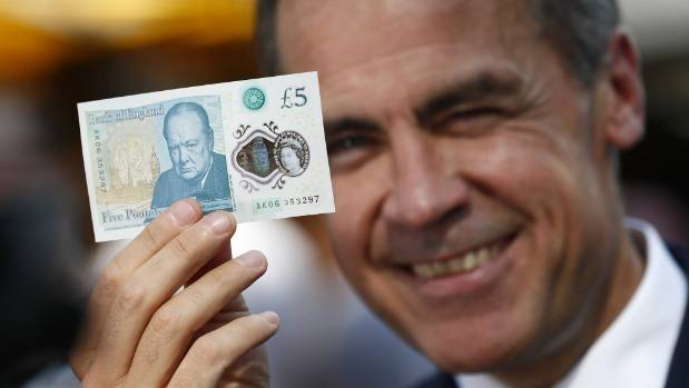 The Bank of England governor Mark Carney showing off the new note.