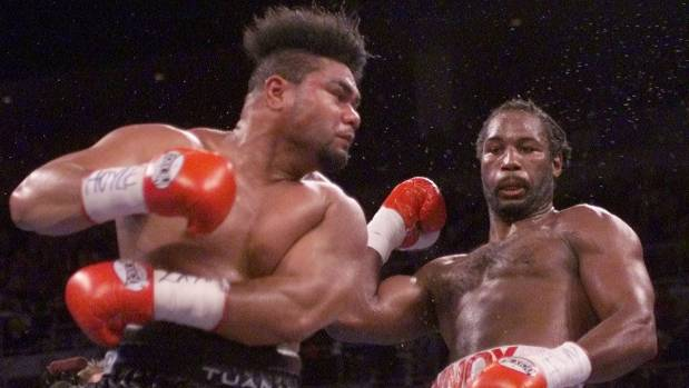David Tua misses as Lennox Lewis sways out of the way of a big left in their world title fight in 2000.