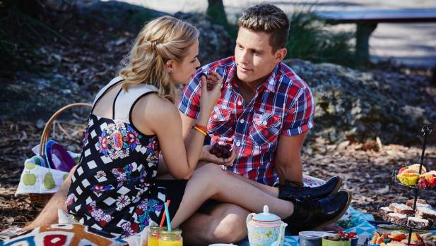 Hunter (Scott Lee) and Olivia (Raechelle Banno) in happier times.