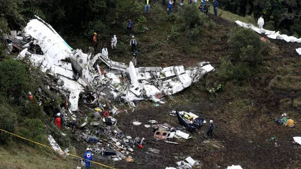Rescue crews work at the scene of the crash in the Colombian jungle near Medellin.